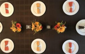 A table set for a fall party.