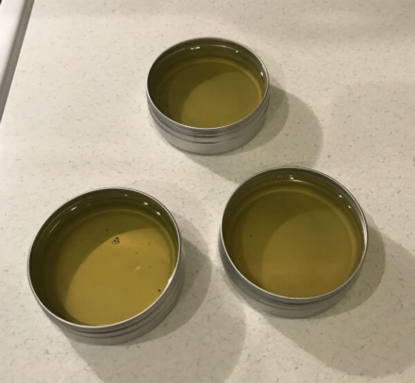 Melted hand salve in tins