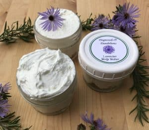 Labeled whipped body butter and two open containers of whipped body butter