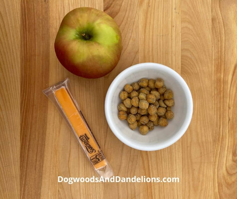 Chickpeas, an apple, and a cheese stick are all healthy snacks.