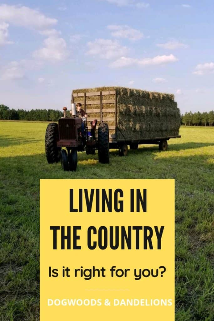 tractor and trailer full of hay on the farm-country living