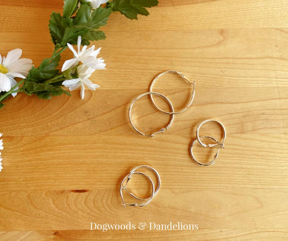 earrings on a wooden background