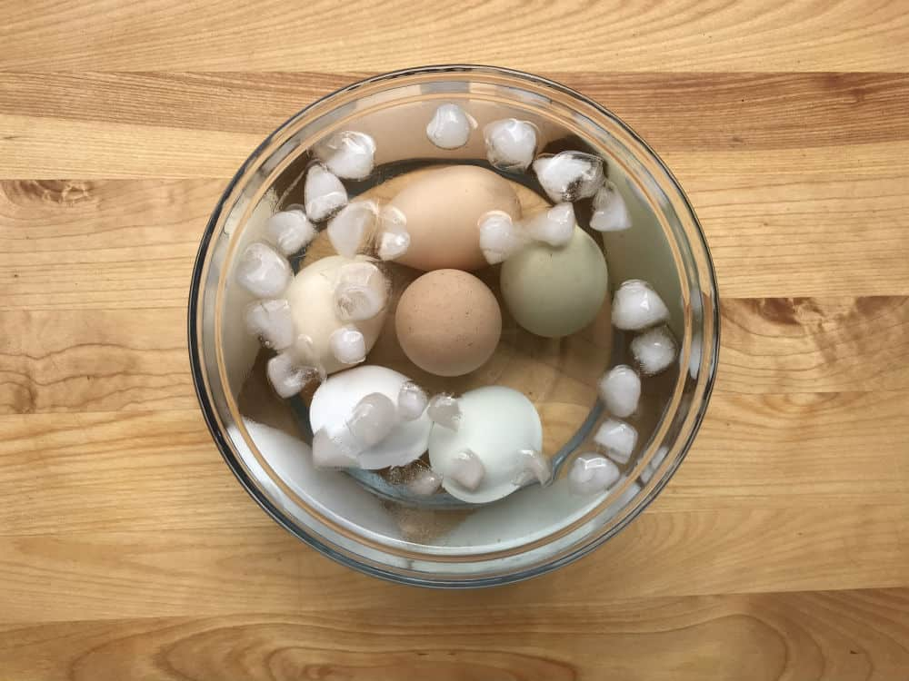Hard boiled eggs in their ice water bath.