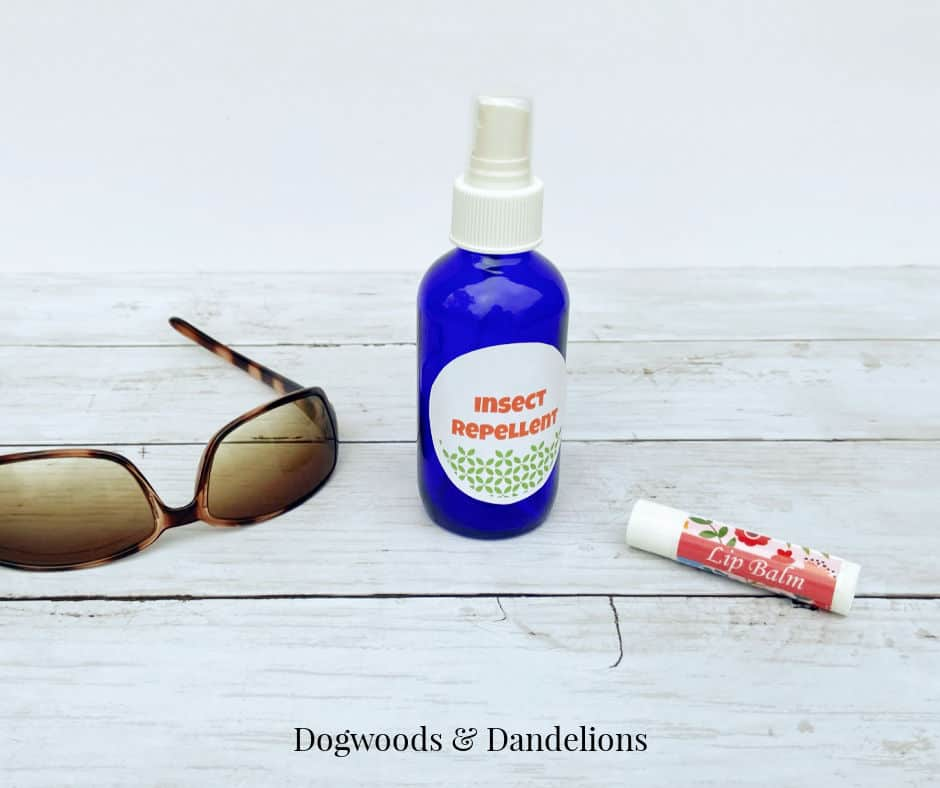 homemade bug spray with essential oils, sunglasses, and lip balm