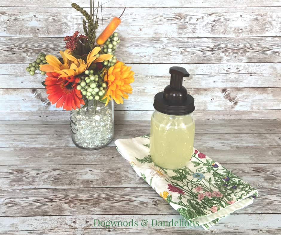 natural foaming hand soap with flowers and towel